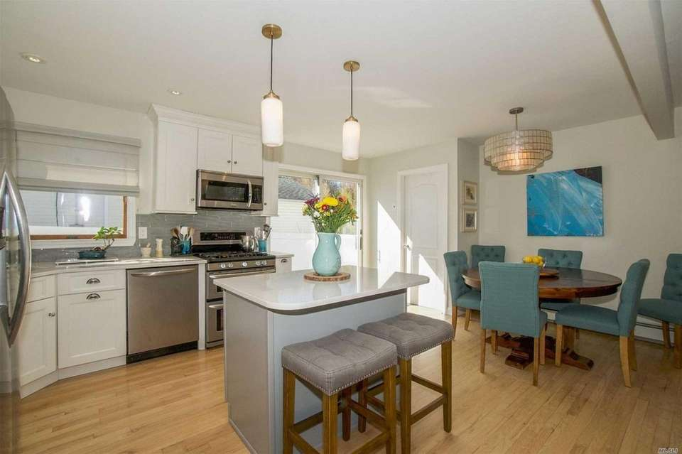 The open concept layout includes a kitchen with