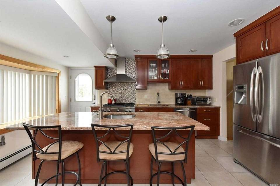 The renovated kitchen includes a center island with