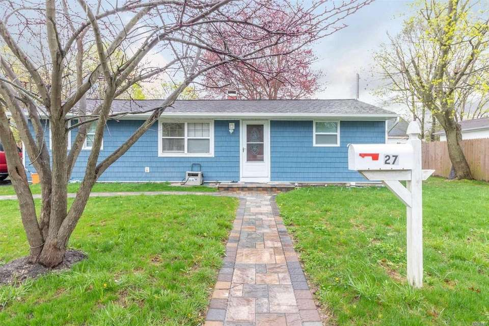 This Central Islip ranch includes four bedrooms and