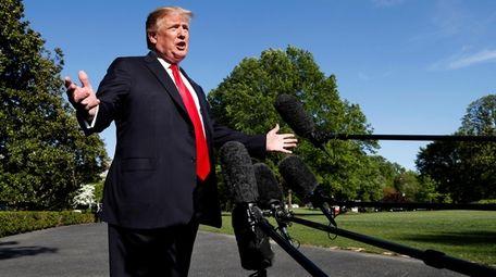President Donald Trump speaks to the media outside