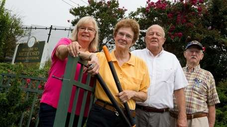 Members of the Medford Volunteer Gardeners Club, from