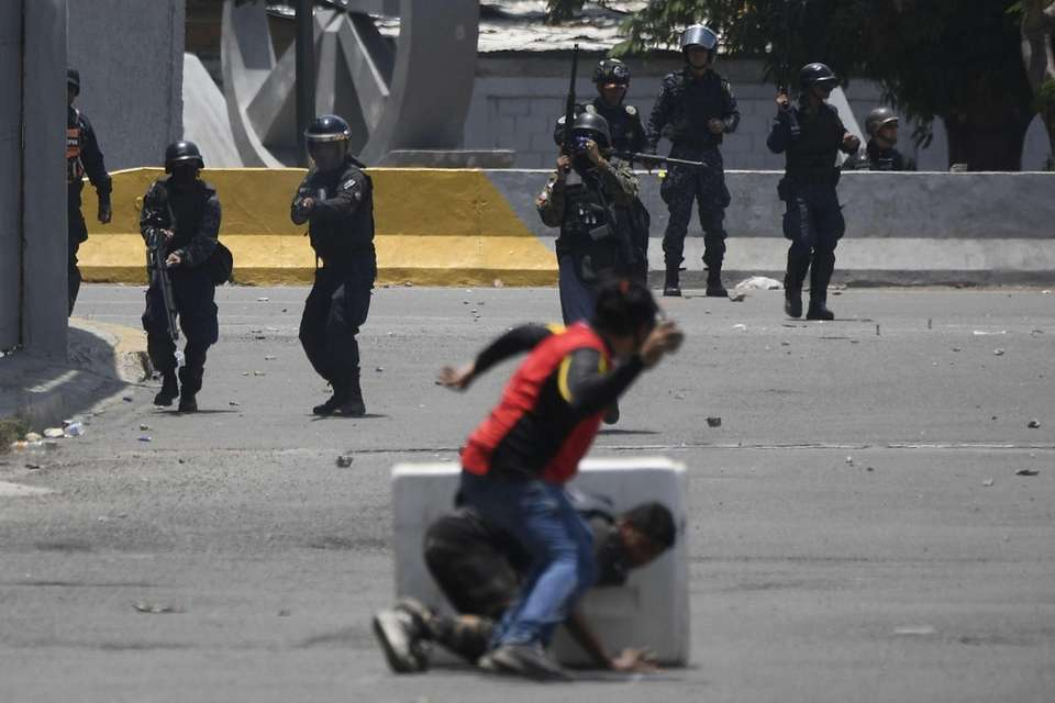 pposition demonstrators clash with soldiers loyal to Venezuelan
