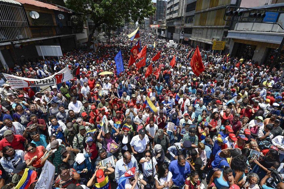 Supporters of Venezuelan President Nicolas Maduro take part