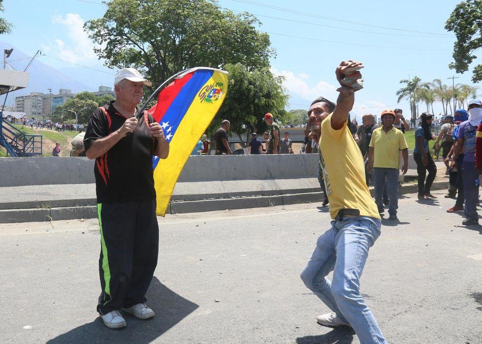 CARACAS, VENEZUELA - APRIL 30: A demonstrator throws