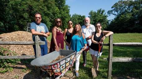 Members of the Baldwin Civic Association's Community Garden gather