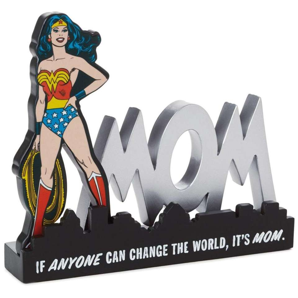 This comic book-inspired desk sign features the saying