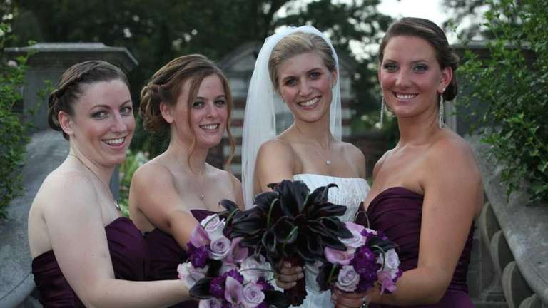 Kate Wrede stands with her bridal party: bridesmaids