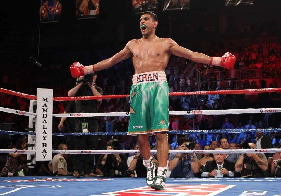 Amir Khan celebrates his fifth round knockout of