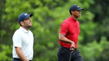 Francesco Molinari of Italy and Tiger Woods of