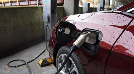 An electric car is hooked up to one