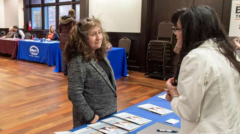 A job seeker talks to a potential employer