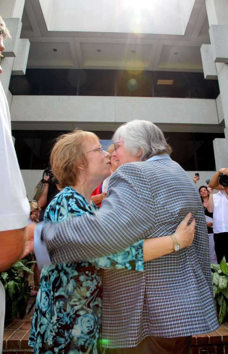 Terry Lehn, left, and Linda Beinhauer kiss during