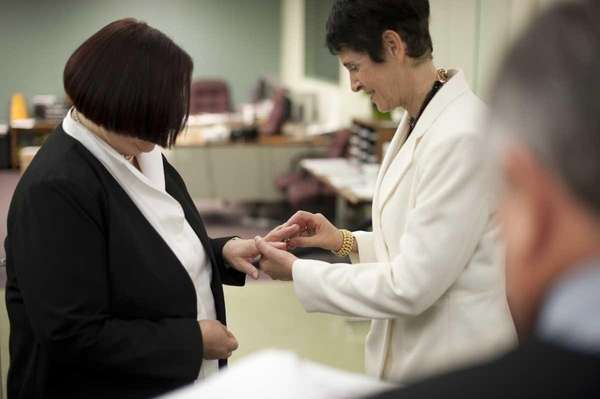 Carol Joy Adelman, left, legally marries Barbara E.