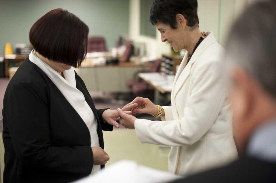 Carol Joy Adelman, left, legally marries Barbara E.
