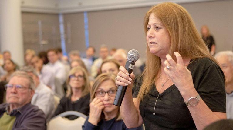 Sherri Hurwitz, of Roslyn Heights, speaks to the
