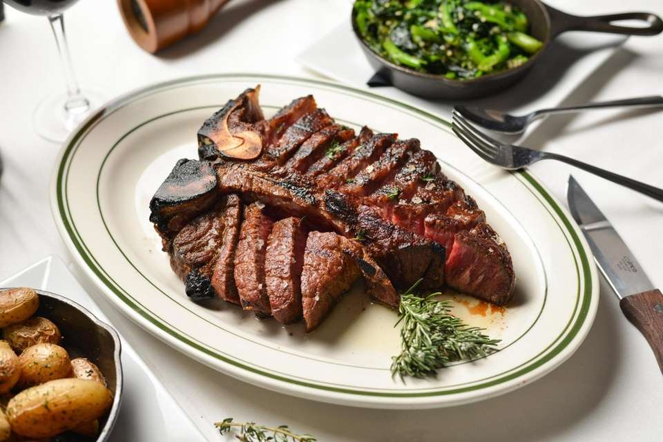 The porterhouse steak for two is served with