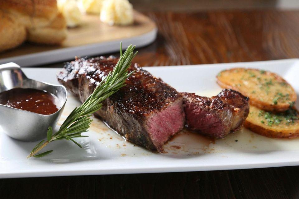 New York strip steak is served at Puglia's