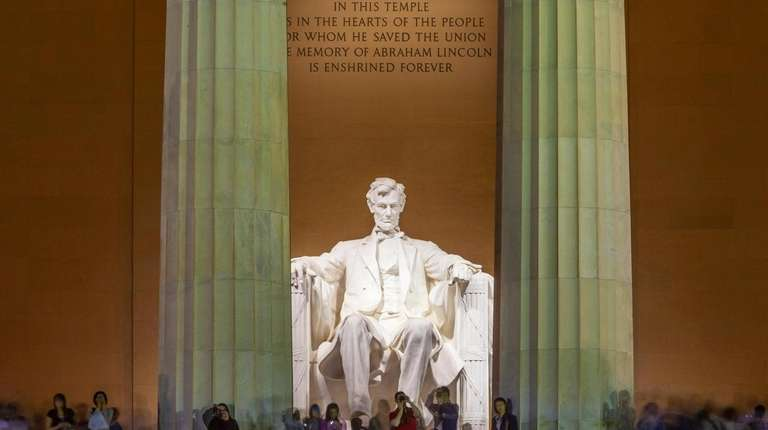 The Lincoln Memorial at twilight. The marble statue