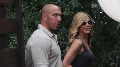 Jennifer Aniston arrives with her bodyguard near the