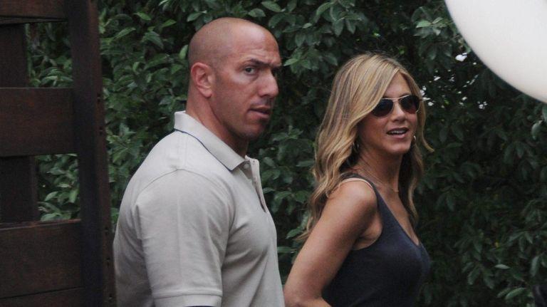 Jennifer Aniston arrives with her bodyguard near the