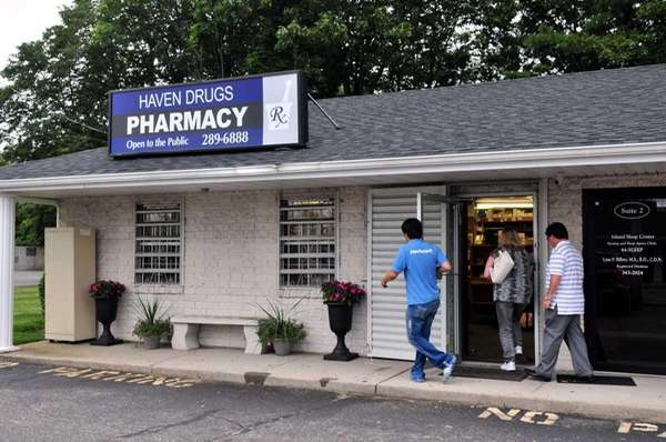 Customers return to the Haven Drugs, which reopened