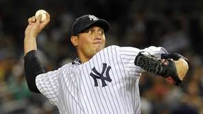 New York Yankees' Freddy Garcia pitches to the