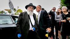 Rabbi Yisroel Goldstein arrives at Chabad of Poway