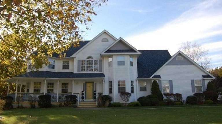 This Manorville Colonial, for $785,000, includes five bedrooms
