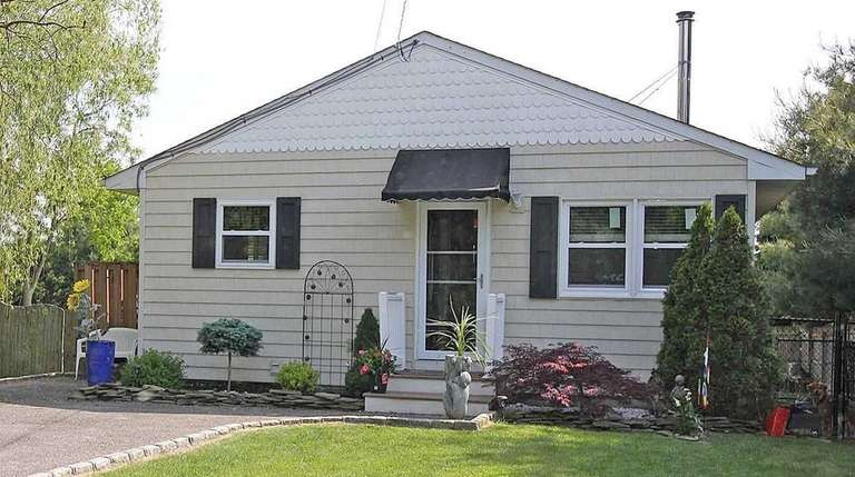This Manorville ranch, for $349,900, includes three bedrooms