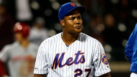 Jeurys Familia #27 of the Mets walks to