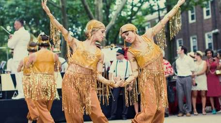 Costumed dancers strike a pose at the Jazz