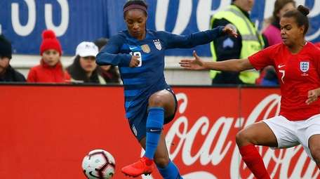 Crystal Dunn #19 of the USA plays in
