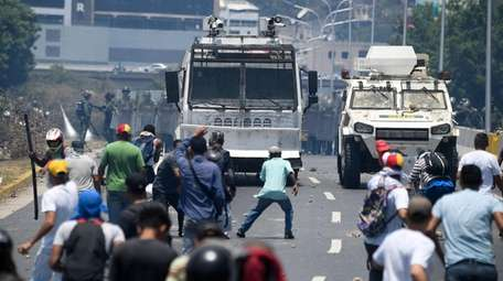 Opposition demonstrators clash with soldiers loyal to Venezuelan