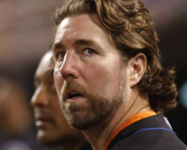 New York Mets pitcher R.A. Dickey watches from