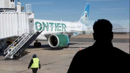 A Frontier plane prepares to leave Long Island
