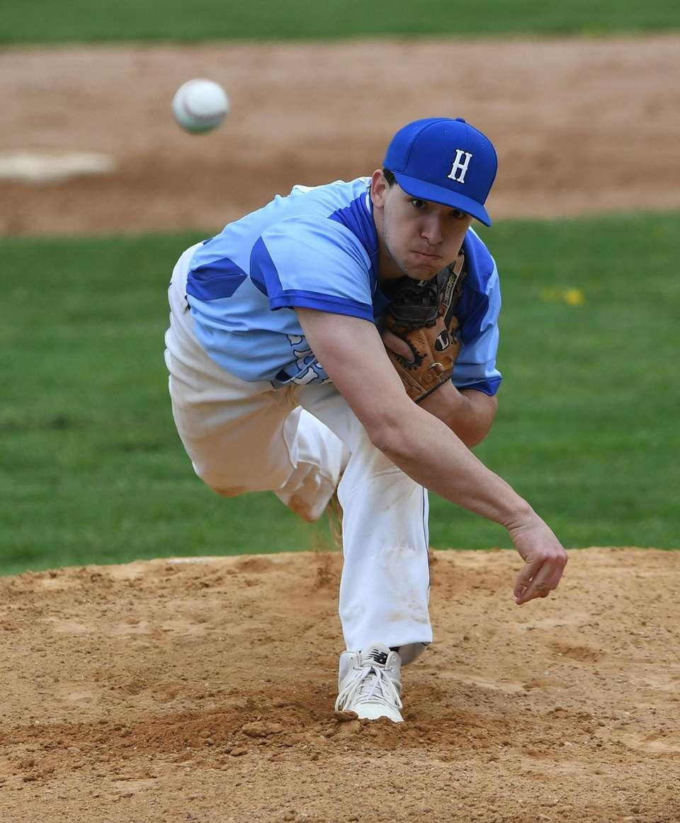 Hauppauge starting pitcher Mike Knopf delivers a pitch