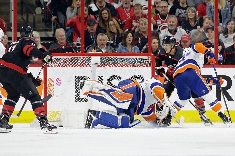 The Hurricanes' Teuvo Teravainen, right, scores against Islanders