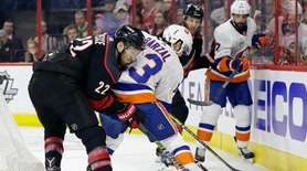 Carolina Hurricanes' Brett Pesce (22) and Islanders' Mathew