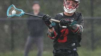 Syosset's Tommy Dolciotto takes the shot during a