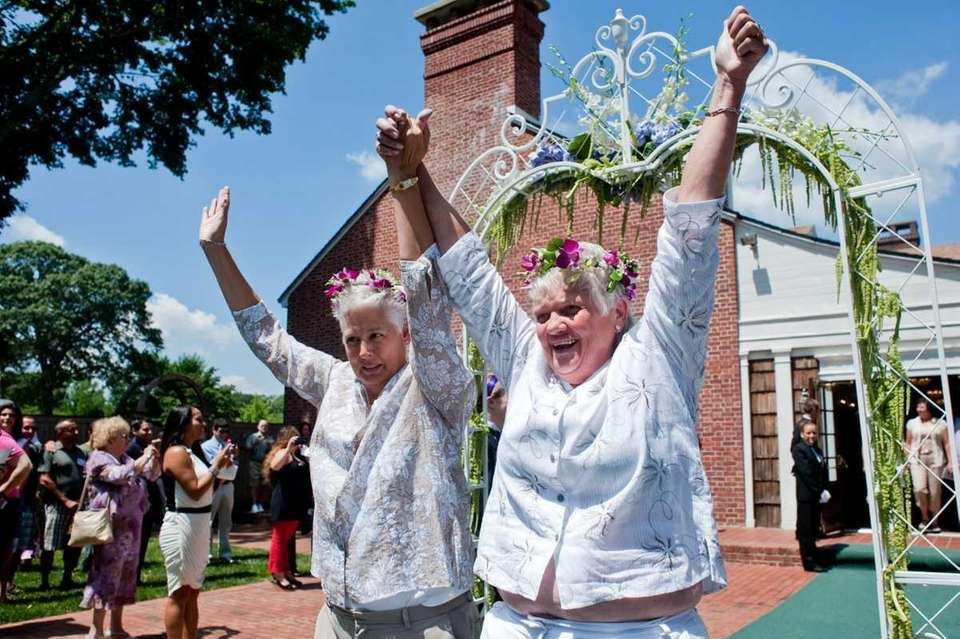 Mary, left, and Kathy Kane, walk down the