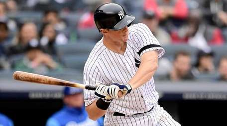 DJ LeMahieu of the Yankees swings at a