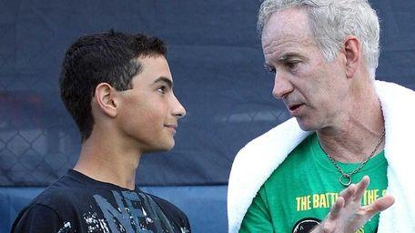 John McEnroe at his tennis academy with Noah