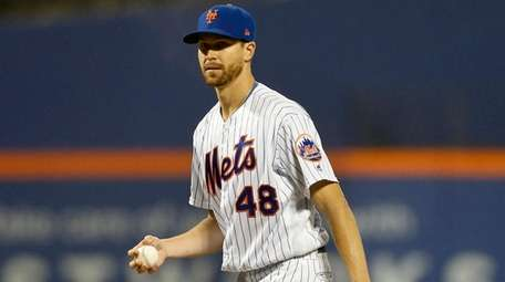 Jacob deGrom of the Mets looks on from