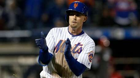 Jeff McNeil of the Mets reacts after his