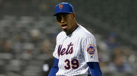 Edwin Diaz of the Mets walks to the