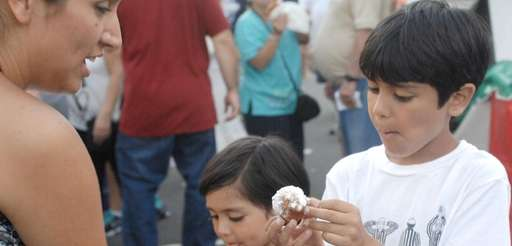 Rocio Porres, of Glen Head, shares zeppoles with