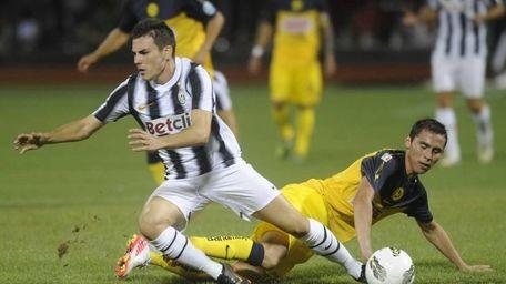 Club America's Paul Aguilar, right, tackles Juventus' Cristian