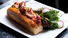 The meat in the lobster roll is tossed