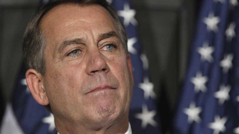 House Speaker John Boehner of Ohio pauses during
