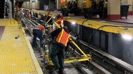 A crew works on Track 18 at Penn